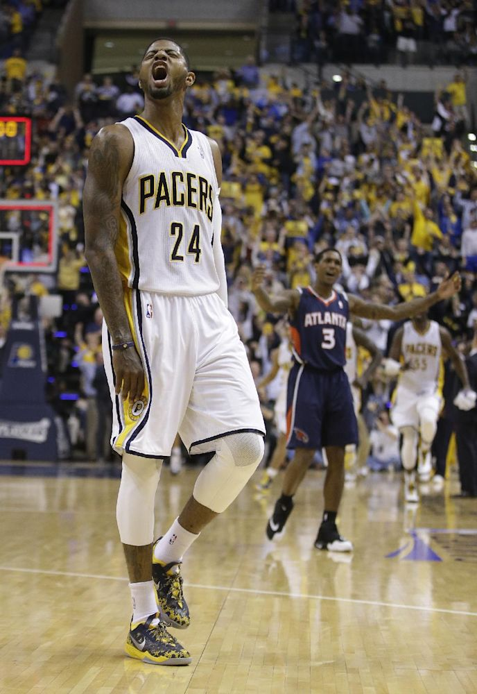 Indiana Pacers' Paul George (24) reacts after hitting a three-point shot at the end of the third quarter during Game 2 of an opening-round NBA basketball playoff series against the Atlanta Hawks Tuesday, April 22, 2014, in Indianapolis. Indiana defeated Atlanta 101-85