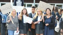 Pupil protest over gender neutral uniform policy sees police called to school gates