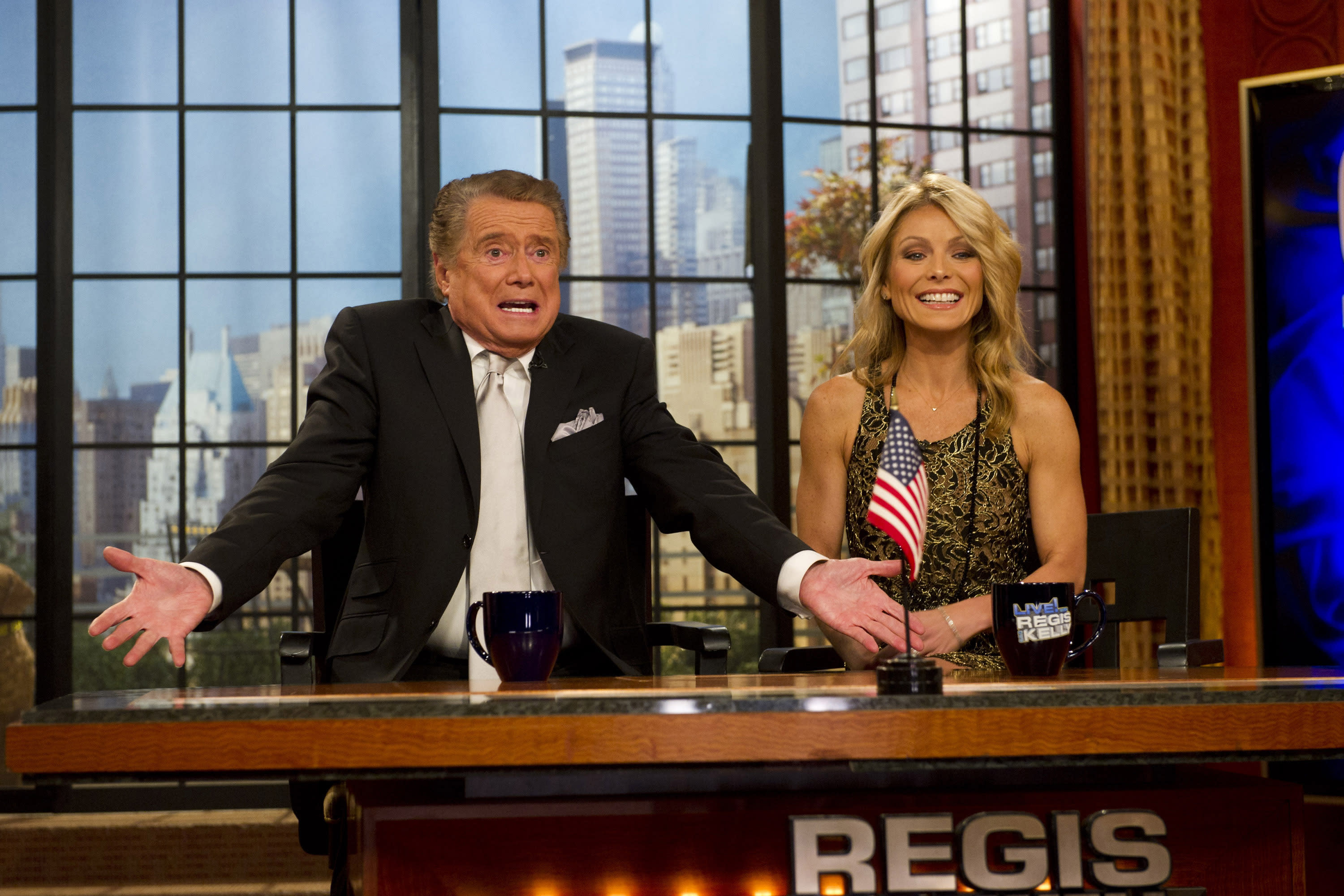 """FILE - In this Nov. 18, 2011 file photo, Regis Philbin and Kelly Ripa appear on Regis' farewell episode of """"Live! with Regis and Kelly"""", in New York. Philbin, the genial host who shared his life with television viewers over morning coffee for decades and helped himself and some fans strike it rich with the game show """"Who Wants to Be a Millionaire,"""" has died on Friday, July 24, 2020. (AP Photo/Charles Sykes, File)"""