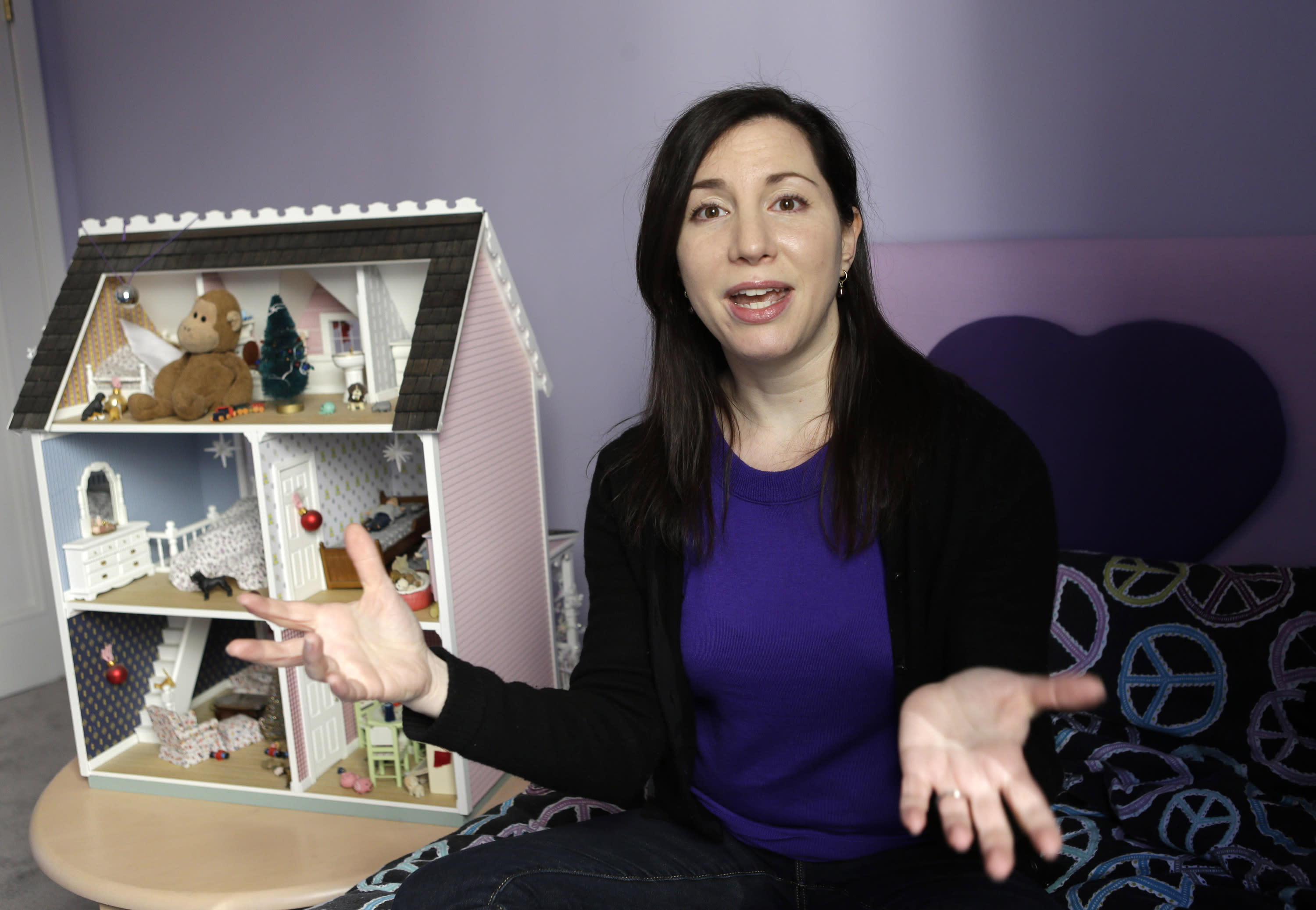In this March 4, 2013 photo, Rebecca Levey, mother of 10-year old twin daughters, poses for a photograph in the girls' bedroom in New York. Levey, who also runs a tween video review site called KidzVuz.com and blogs about technology and educations issues, says, ìWhat sex education used to be_ it's now the 'technology talk' we have to have with our kids.î She explains that children need to understand the pitfalls of carelessly sharing personal information online. (AP Photo/Kathy Willens)
