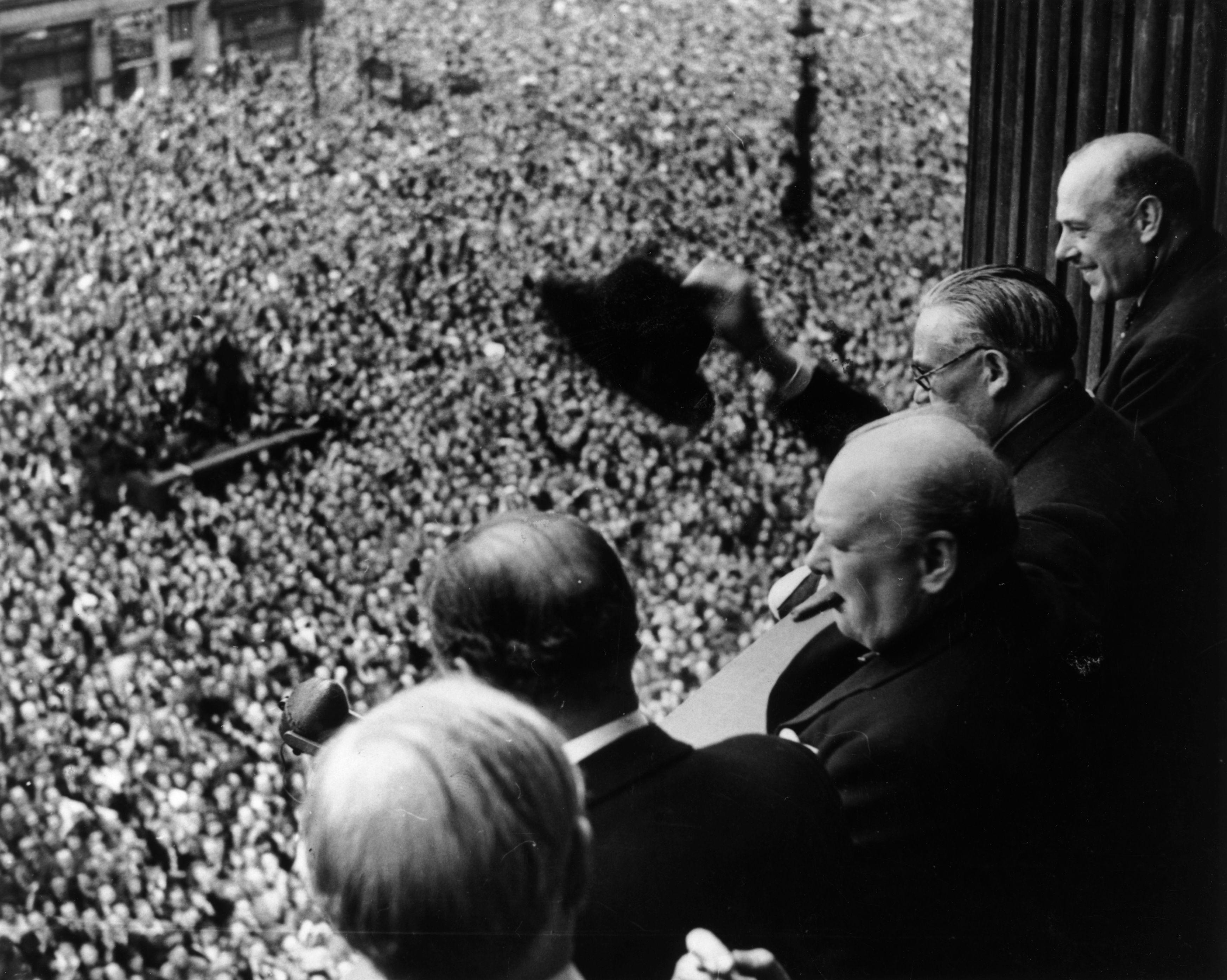 British Prime Minister Winston Churchill (1874 - 1965) waving to crowds gathered in Whitehall on VE Day, 8th May 1945. (Photo by Keystone/Hulton Archive/Getty Images)
