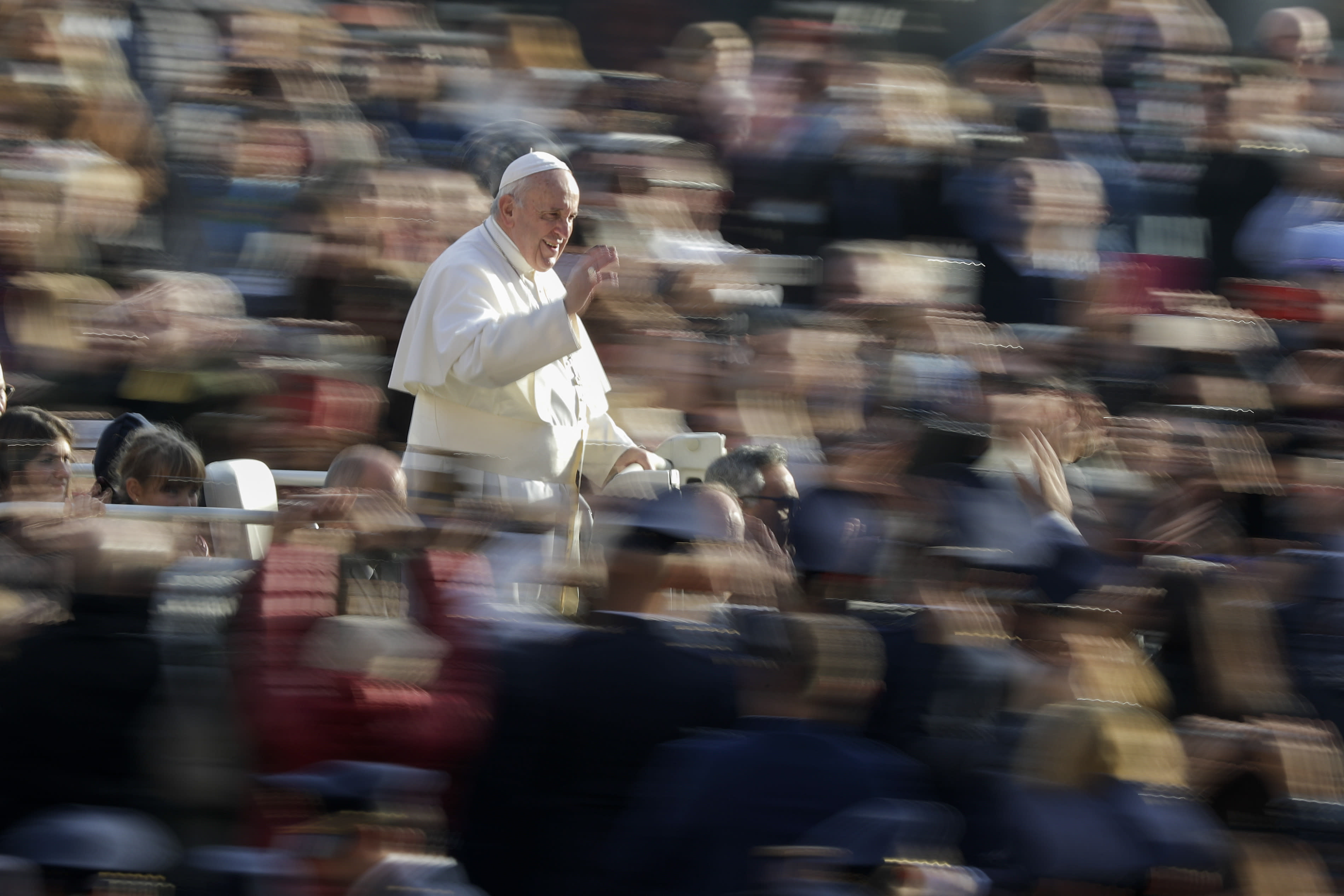 Pope Francis waves to faithful as he arrives for his weekly general audience, in St. Peter's Square, at the Vatican, Wednesday, Nov. 27, 2019. (AP Photo/Andrew Medichini)