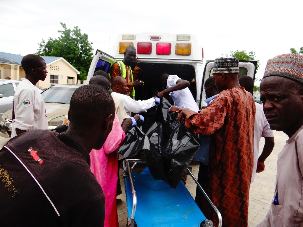 A victim is brought to the State Specialist Hospital in Maiduguri, northeastern Nigeria on July 29, 2017 (AFP Photo/)