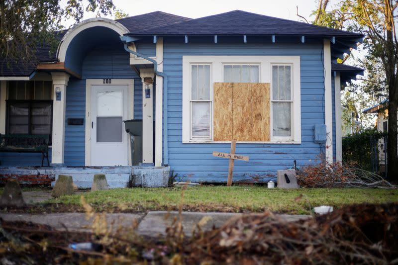 A house with a boarded up window is seen after Hurricane Delta in Lake Charles