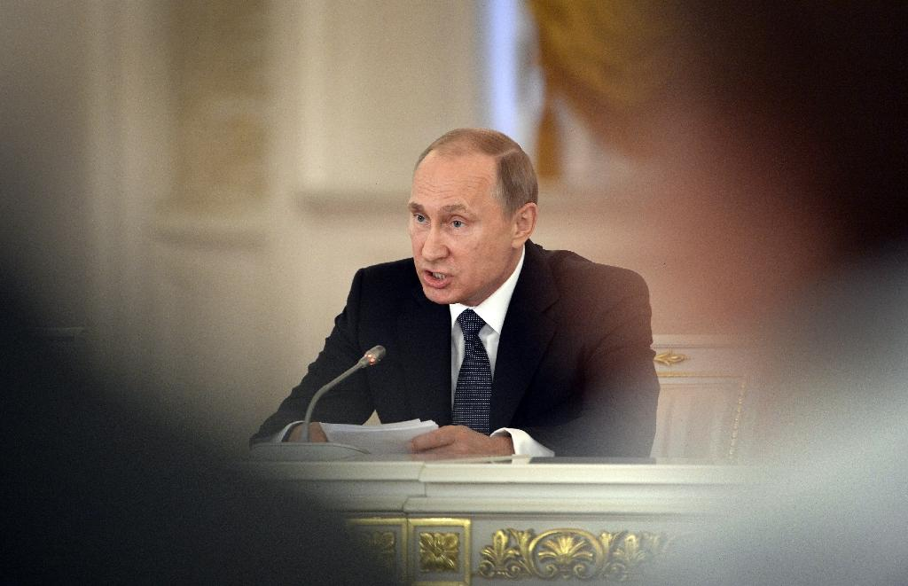 "Russian President Vladimir Putin has signed a law that enables authorities to ban ""undesirable"" foreign NGOs"