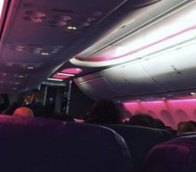 Plane full of Women's March supporters headed to Washington, D.C. turns on pink cabin lights