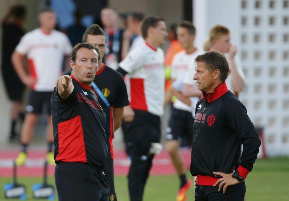 Belgium's coach Marc Wilmots talks with an assistant during a training session at Estadio Manoel Barradas stadium in Salvador