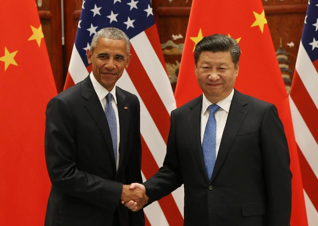 Under President Barack Obama (L) Washington's pivot to Asia was viewed with alarm in Beijing (AFP Photo/How Hwee Young)