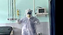 Dancing In The Dark: Doctor Cheers Up COVID-19 Patients By Busting Moves In Med Gear