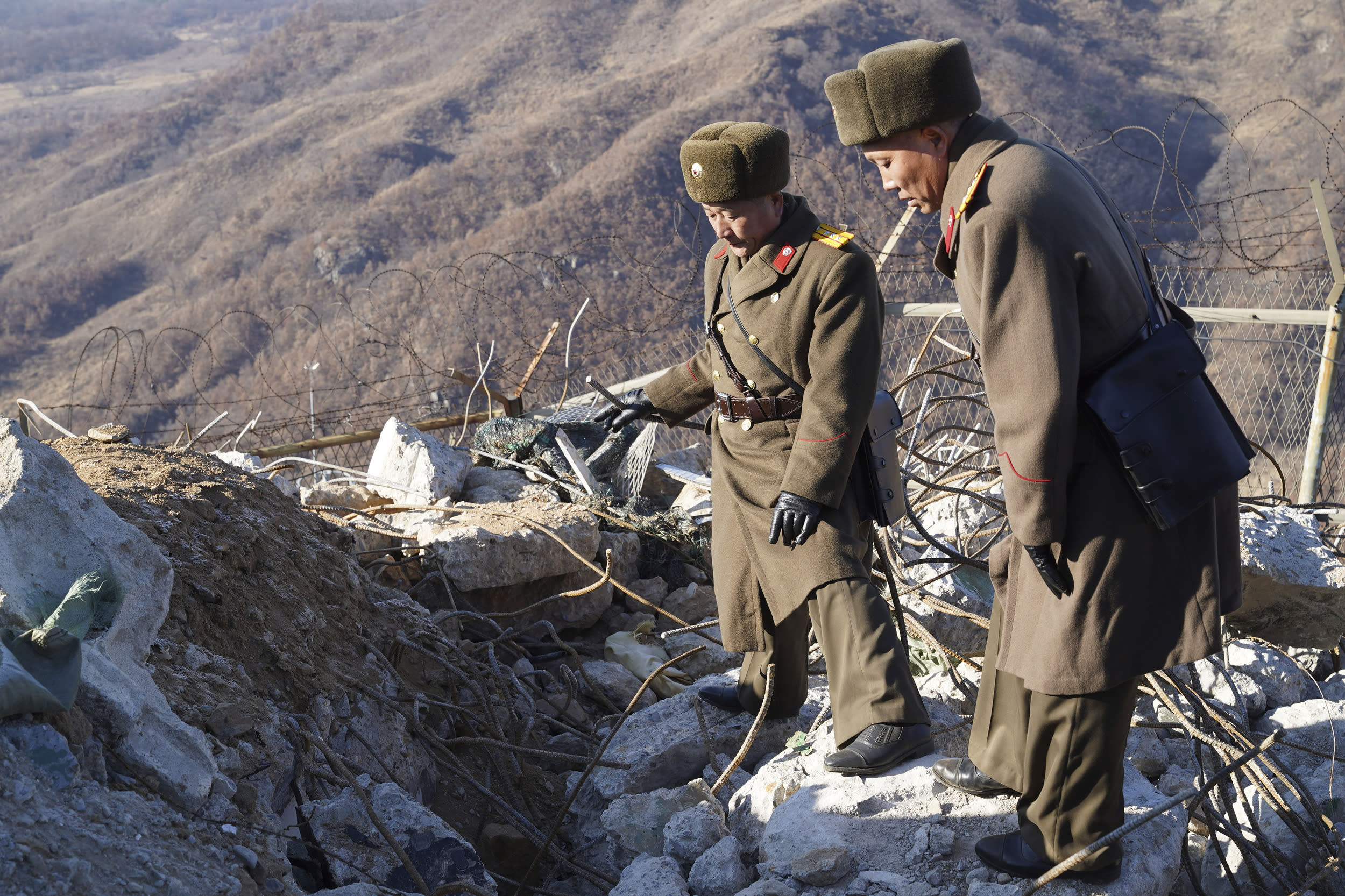 Dec 17, 2018-Cheorwon, South Korea-In this photo provided by South Korea Defense Ministry, a South Korean and North Korean army soldier takes a inspect at the dismantled North Korean guard post inside the Demilitarized Zone (DMZ) in the central section of the inter-Korean border in Cheorwon, North Korea. South Korea's military on Monday confirmed the demolition and disablement of some North Korean border guard posts (GPs) through its onsite verification last week and days of subsequent analysis. The Joint Chiefs of Staff (JCS) announced the results of its Dec. 12 work to verify the demolition of 10 North Korean GPs in the Demilitarized Zone (DMZ) and the disarmament of another. The North's military also carried out the verification work on the same day. As part of a boarder accord to reduce military tensions and build trust, Seoul and Pyongyang initially agreed to demolish 11 GPs each. But they decided later to keep one of them apiece, albeit unarmed, in light of their historical value.  (Photo by Seung-il Ryu/NurPhoto via Getty Images)