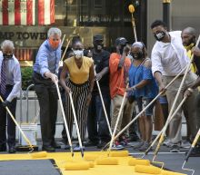 Mayor helps paint 'Black Lives Matter' outside Trump Tower