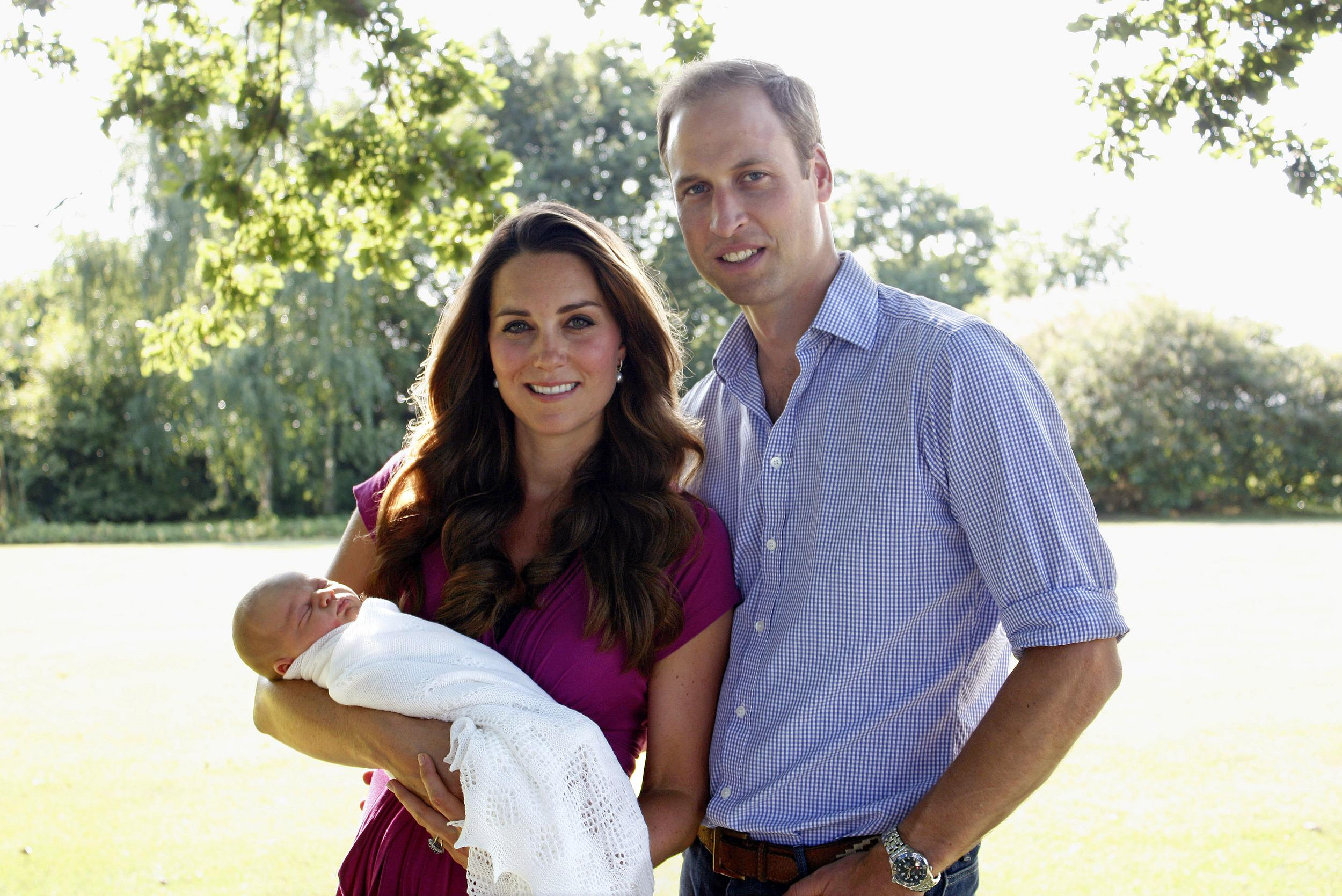 Kate and William pose with Prince George for the family's first official portraits at her family's home.