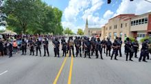 Live updates from weekend protests: Armed militia groups in Louisville; judge blocks Seattle's pepper spray ban