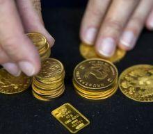 Gold hits one-week high on muted dollar, U.S. stimulus hopes