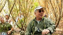 Paul Simon plants a tree at Hawaii forest preserve on Maui