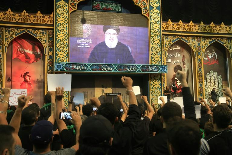 Hezbollah supporters gathered in the movement's southern Beirut stronghold to watch Nasrallah's speech on a big screen