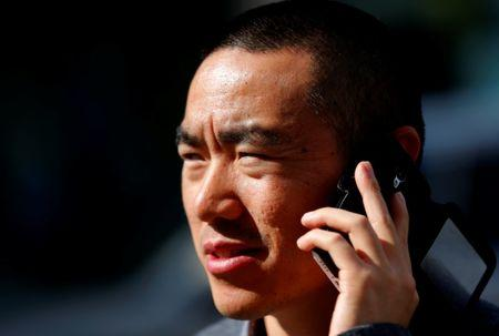 Yan Ding, a Chinese immigrant to Hungary who received an EU residency permit through the purchase of a special 300,000 euro government bond, talks on his phone in Budapest September 28, 2016. REUTERS/Laszlo Balogh
