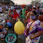 India's coronavirus tally overtakes Brazil; thousands join ritual bath