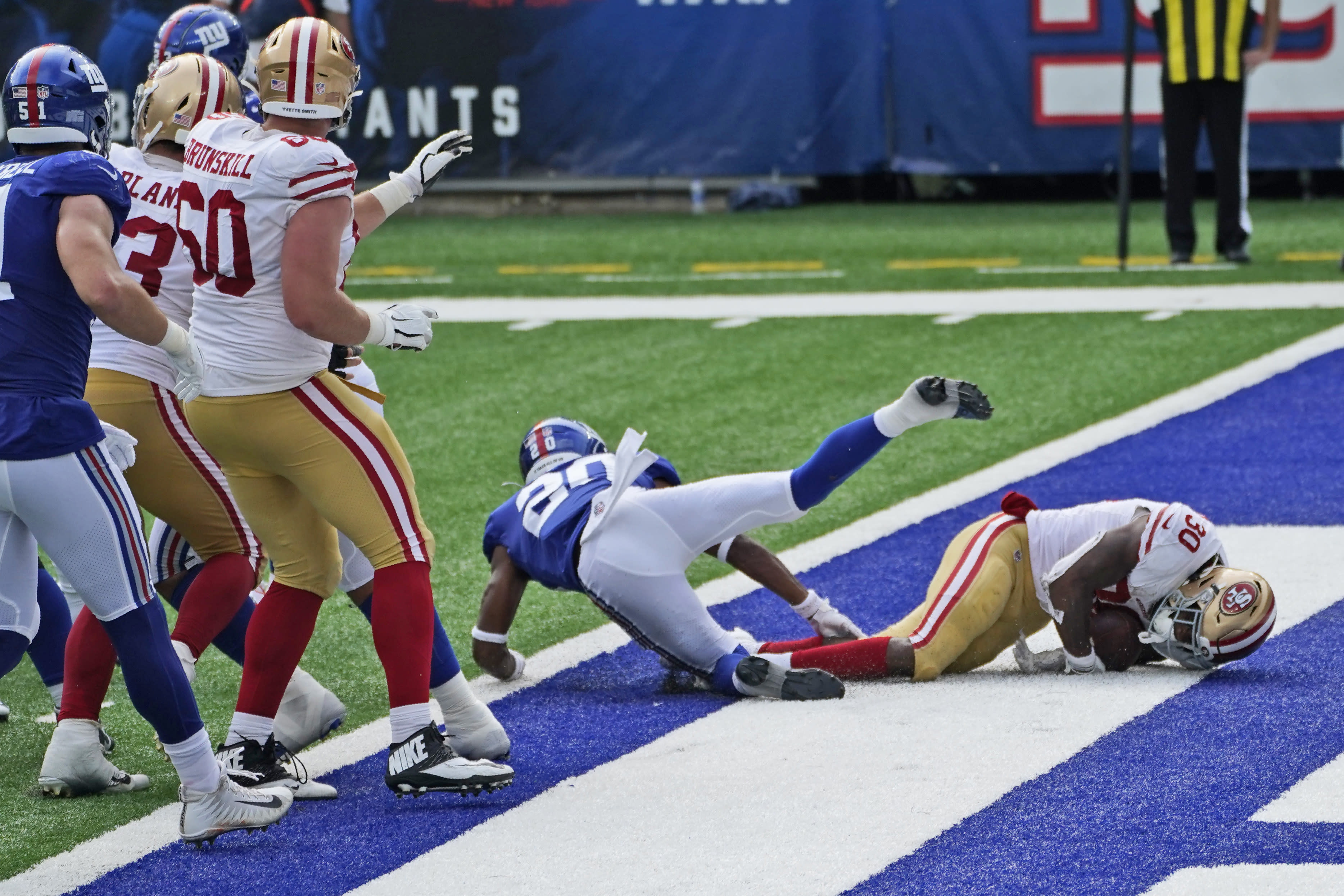 San Francisco 49ers' Jeff Wilson, right, scores a touchdown during the second half of an NFL football game against the New York Giants, Sunday, Sept. 27, 2020, in East Rutherford, N.J. (AP Photo/Corey Sipkin)