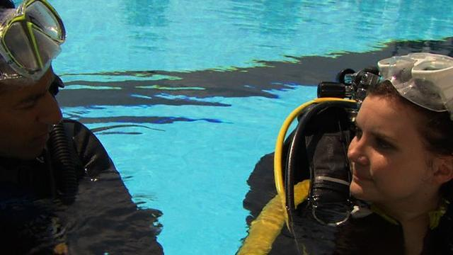 Diving may give hope to paralysis patients