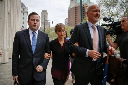 "Actor Allison Mack, known for her role in the TV series ""Smallville"", arrives with her lawyers for a hearing on charges of sex trafficking in relation to the Albany-based organization Nxivm at United States Federal Courthouse in Brooklyn, New York, U.S., May 4, 2018. REUTERS/Brendan McDermid"