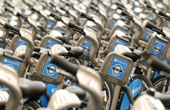 New bicycles for hire stand in rows after being assembled at a storage facility in London, July 9, 2010, before the launch of a public bicycle sharing scheme for short journeys on July 30. The scheme, aimed at tackling overcrowding on the capital's commuter networks, is expected to generate an additional 40,000 bicycle journeys per day in the city. REUTERS/Suzanne Plunkett (BRITAIN - Tags: SOCIETY TRANSPORT)