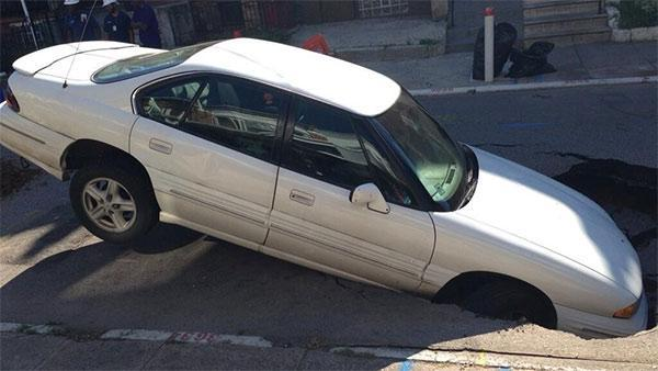 Sinkhole partially swallows car in Hunting Park