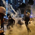 Hong Kong protesters tear gassed by police after alleged attack on officer