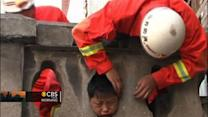 Boy gets head stuck in stone railing