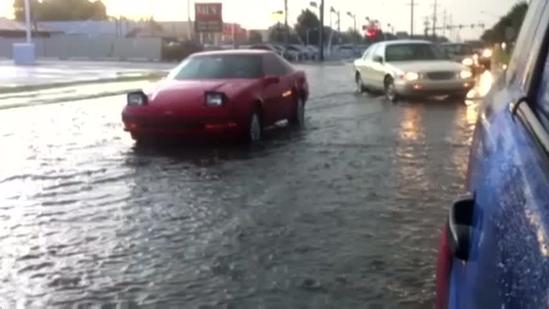 Car stuck in flood waters in Warr Acres