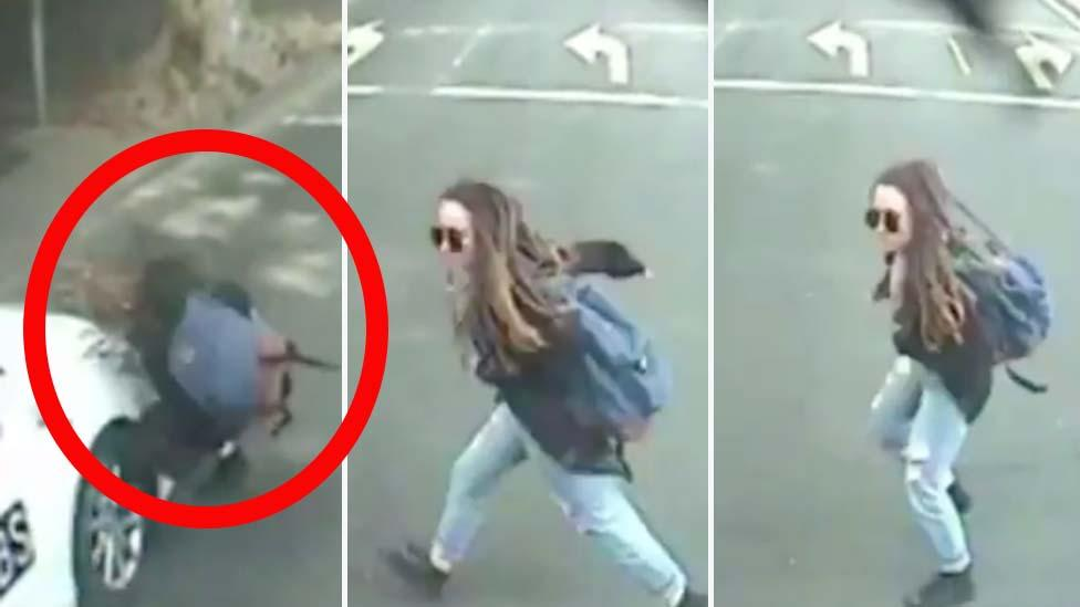 Disturbing video shows 'zombie pedestrians' wandering into traffic