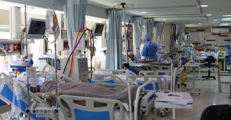Tehran scrambles for hospital beds as Iran reports record new coronavirus cases