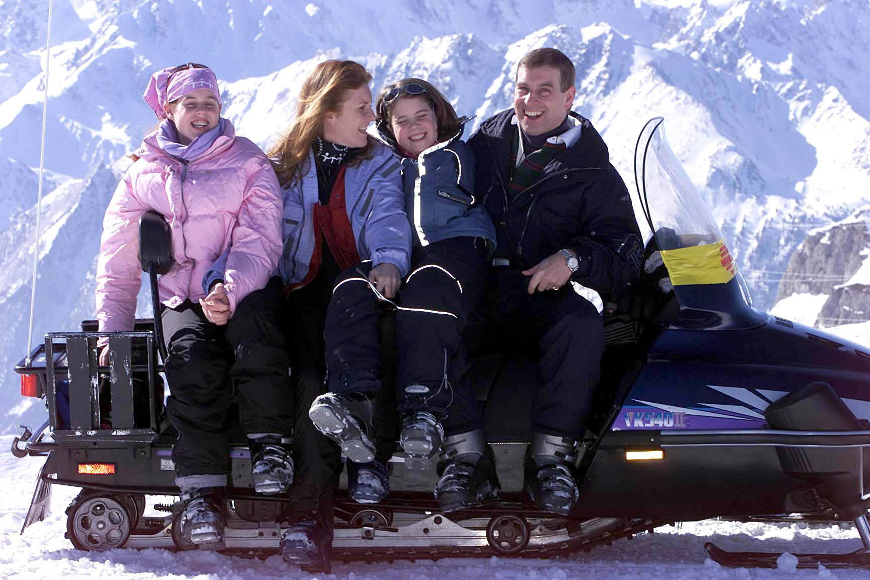 The Duke of York with his daughters Princess Eugenie (left) and Princess Beatrice (right) during their ski-ing holiday in the Swiss Alps.  The Duke was celebrating his 41st birthday on holiday with his ex-wife and children.   * The birthday is a double celebration for the family, who toasted Princess Eugenie's success at passing a school entrance exam. Ten-year-old Eugenie's exam success means she will now enrol at a private school near Windsor Castle.