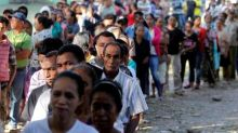 East Timorese form long lines to vote in parliamentary election