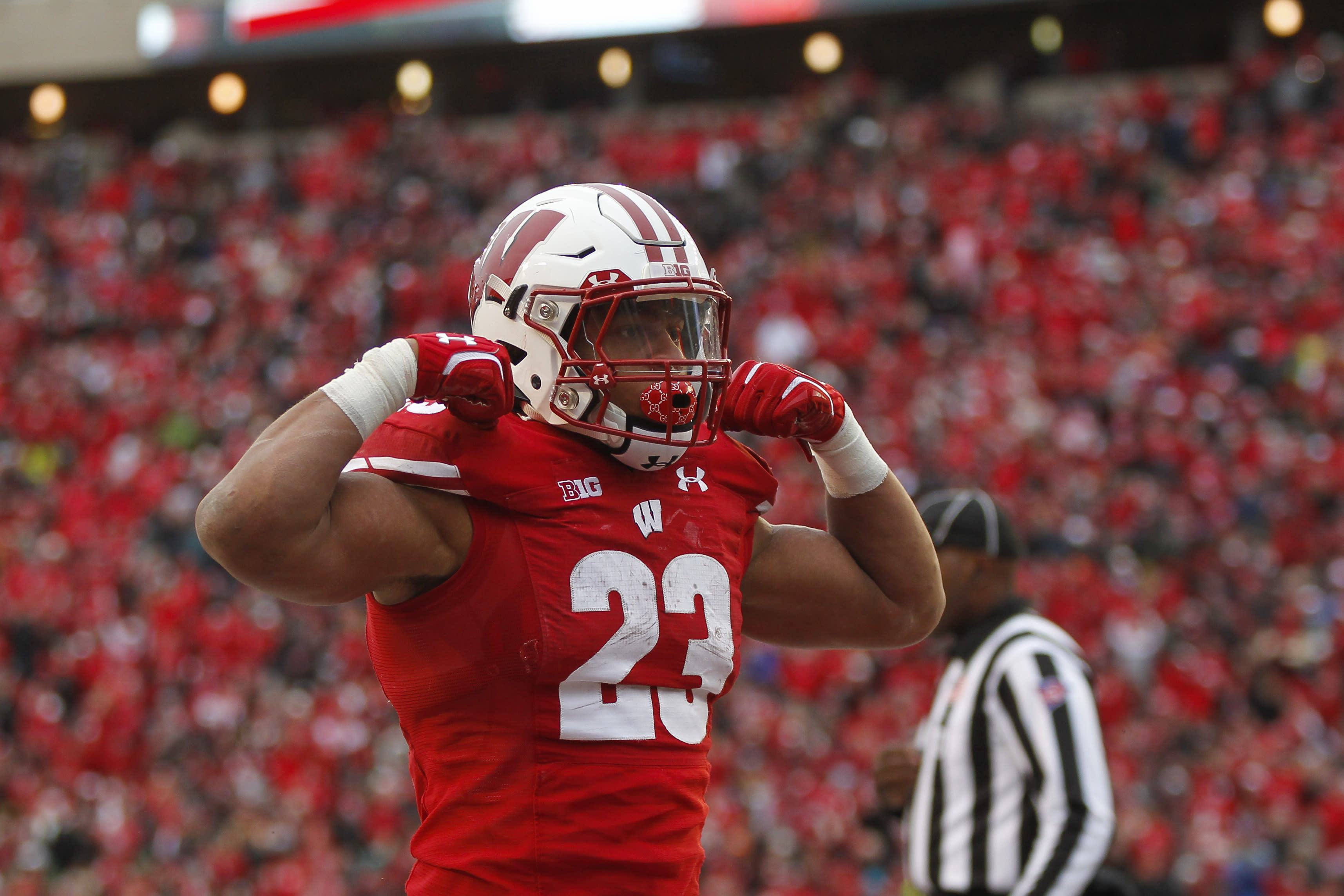Wisconsin running back Jonathan Taylor celebrates a touchdown against Michigan State during the second half of an NCAA college football game Saturday, Oct. 12, 2019, in Madison, Wis. Wisconsin won 38-0. (AP Photo/Andy Manis)