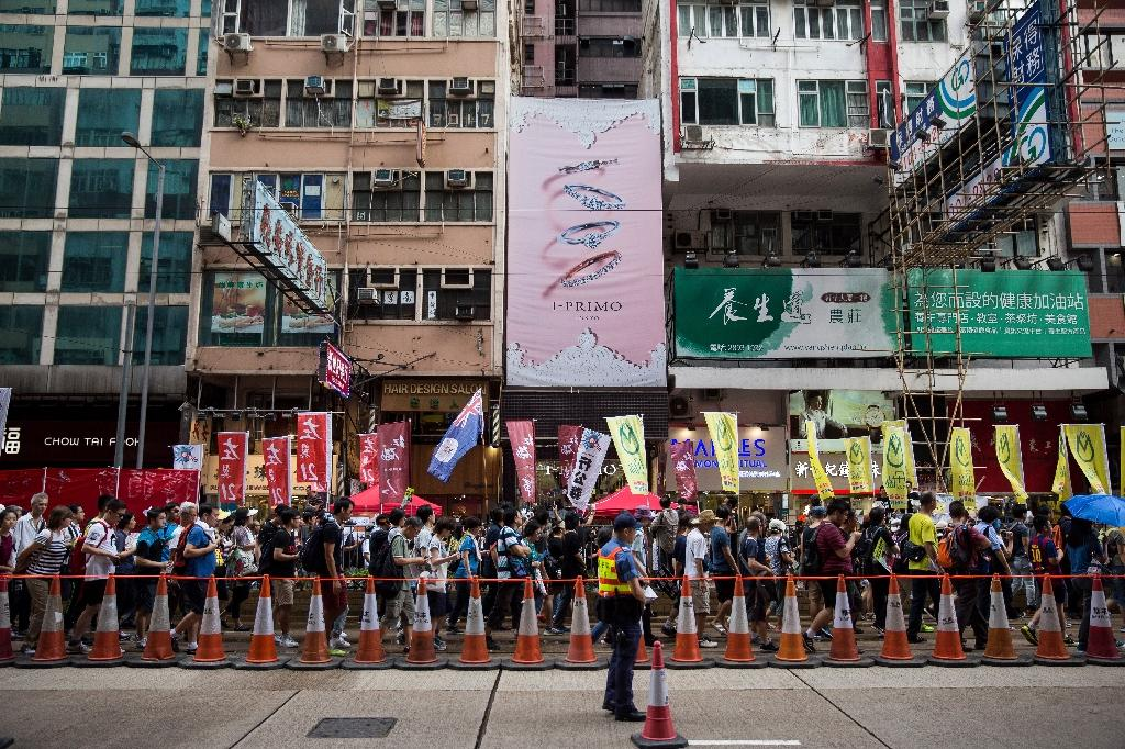 People attend a protest march in Hong Kong on July 1, 2017, coinciding with the 20th anniversary of the city's handover from British to Chinese rule (AFP Photo/Isaac LAWRENCE)