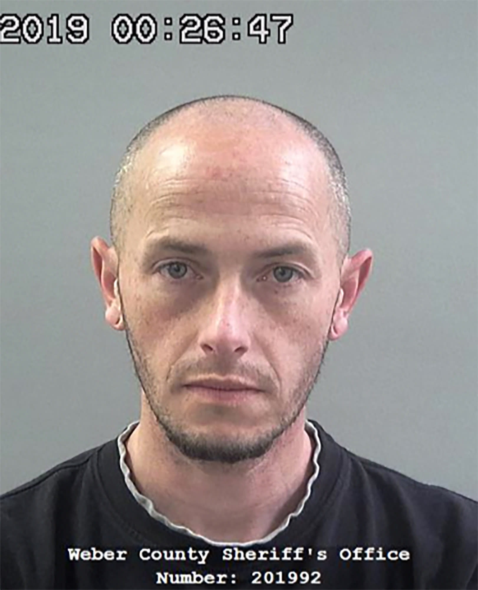 This 2019 photo provided by the Weber County Sheriff's Office shows inmate Matthew Belnap. A California man who was behind bars for bank fraud escaped from a Utah jail Tuesday night by posing as Belnap, a fellow inmate whose time had come to be released, authorities said Wednesday Feb. 26, 2020. Inmate, Kaleb Wiewandt was allowed to leave the jail in Ogden, Utah, because staff thought he was Belnap, who helped him carry out the plan, said Weber County Sheriff's Lt. Joshua Marigoni. Belnap who supposed to be freed Tuesday night after spending more than 70 days in jail after pleading no contest last year to retail theft charges, he said. ( Weber County Sheriff's Office via AP)