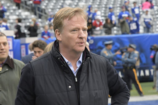 FILE - In this Oct. 20, 2019, file photo, NFL Commissioner Roger Goodell walks on the field before an NFL football game between the New York Giants and the Arizona Cardinals in East Rutherford, N.J. NFL Goodell reiterated the leagues support for players fighting for racial justice and protesting police violence. Citing a police officer shooting Jacob Blake in the back on Aug. 23 in Kenosha, Wisconsin, Goodell said the incident has brought forth more feelings of anger, frustration, anguish, fear for many of us in the NFL family. The investigation into the police shooting of Blake, who is Black, is ongoing. (AP Photo/Bill Kostroun, File)