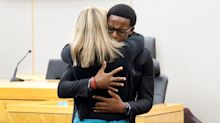 'Is this OK?' Former policewoman who shot dead black neighbour is hugged by victim's brother as she's jailed