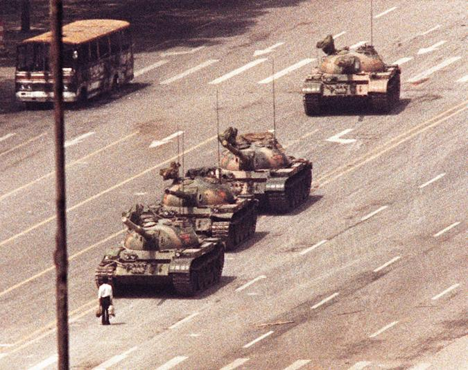 A man stands in front of a convoy of tanks in the Avenue of Eternal Peace in Tiananmen Square in Beijing in this June 5, 1989 photo.