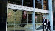 Reserve Bank of Australia holds cash rate at record low, signals weaker growth in March quarter