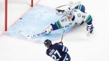 Connor Hellebuyck backstops Jets to 4-1 win over Canucks in NHL exhibition play