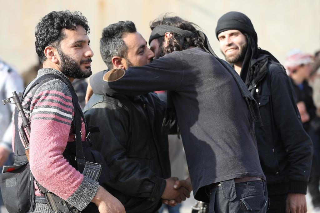 A monitor says 36 pro-government fighters have been killed in a district of the Syrian capital overrun by Islamic State group jihadists in a surprise nighttime attack, including areas evacuated by Al-Qaeda's onetime Syrian branch on March 13, 2018