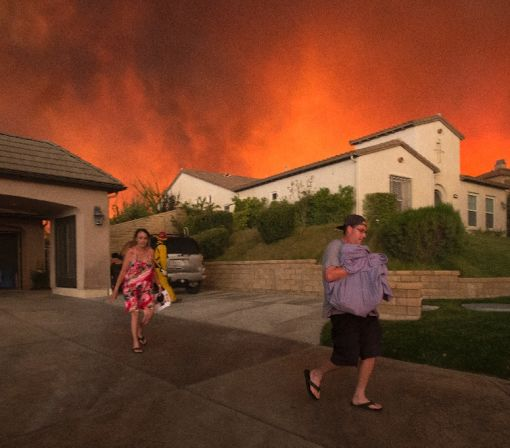 Southern California fire mushrooms, residents evacuated