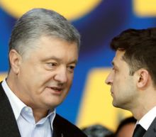 Ukrainian presidential candidates trade insults in rowdy stadium debate