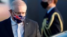 Australian PM spurns industry pleas to reopen border before 2022