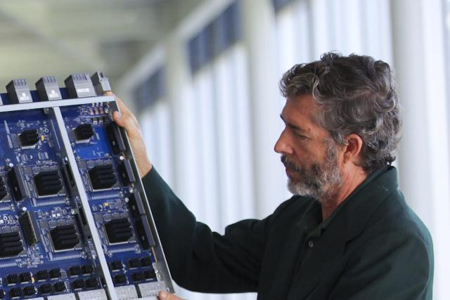 David Cheriton, founder of Arista Networks, with a data-routing switch in Santa Clara, Calif., Oct. 21, 2011.