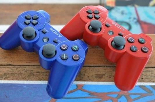 DualShock 3 controllers in red, blue this October