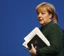 Eyeing re-election, Germany's Merkel takes tougher tone on migrants