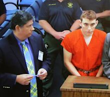 Couple looking after Florida shooting suspect say they had no idea there was a 'monster living under our roof'